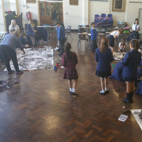 Local artist Jane Simpson worked with the students to create their giant STEAM pictures