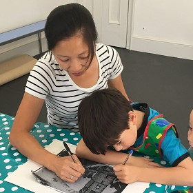 Family drawing together in our learning studio