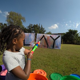Action painting with water guns on the Braeburn Field